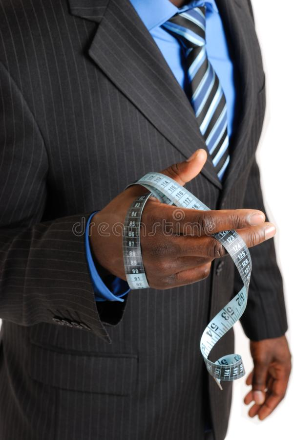 Download Business Man Holding Tape Measure Stock Image - Image: 8023781