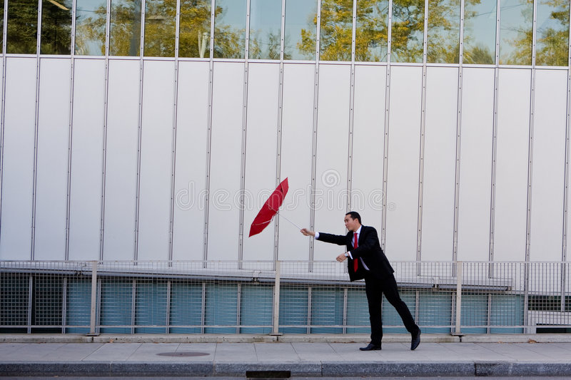 Download Business Man Holding On To His Umbrella Stock Image - Image: 7830755