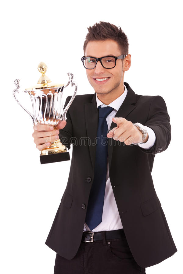 Download Business Man Holding A Trophy And Pointing Stock Photo - Image of choose, hair: 24441124