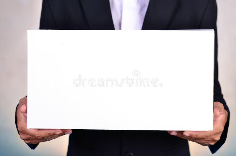 Business man holding white box. Close up business man holding white box stock photos