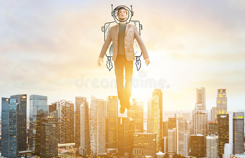 Business man hover over city skyline. Business Advantage. Businessman in sketch astronaut costume hovering over down town on sunset stock images