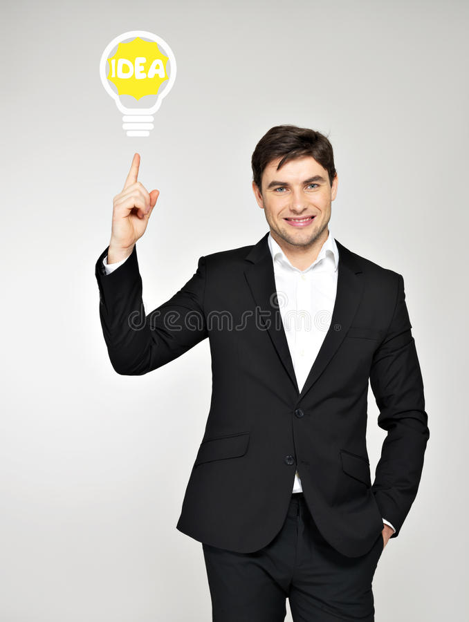Business man with an idea bulb. Young handsome business man with an idea bulb stock photography
