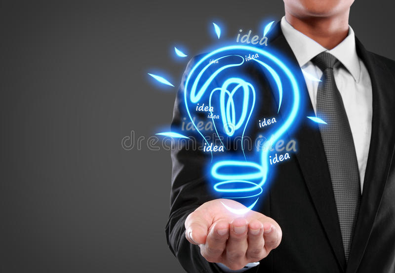 Business man with idea light bulb. On virtual background stock images