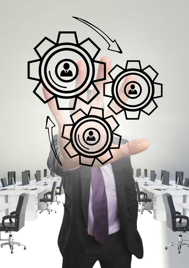 Business man interacting with people in cogs graphics against office background vector illustration
