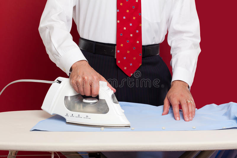 Business man ironing his clothes royalty free stock photos