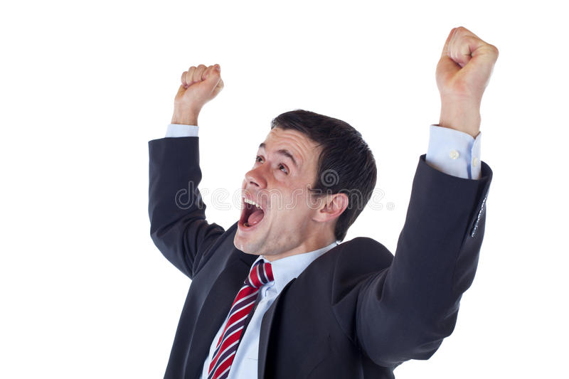 Business man jubilates with raised clenched fists