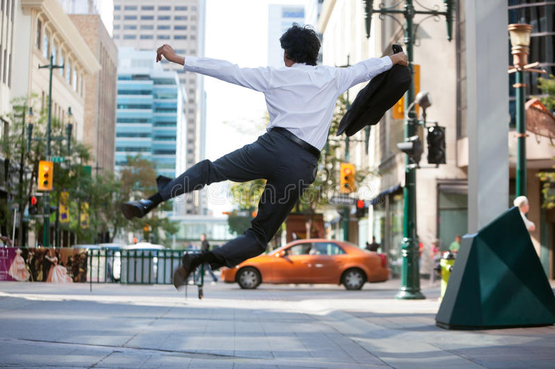 Download Business Man Jumping In Air Stock Photo - Image: 21775538