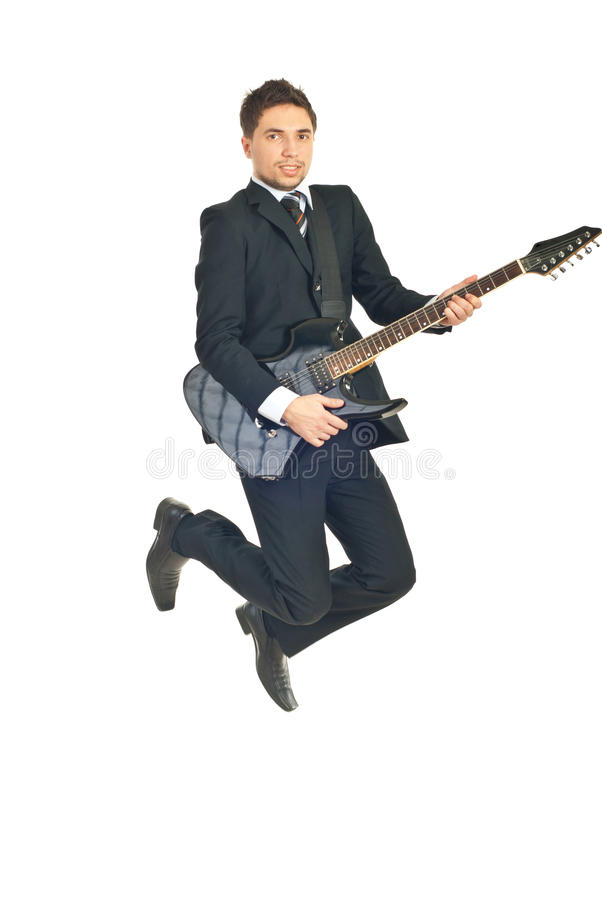 Business man jumping with guitar royalty free stock photo
