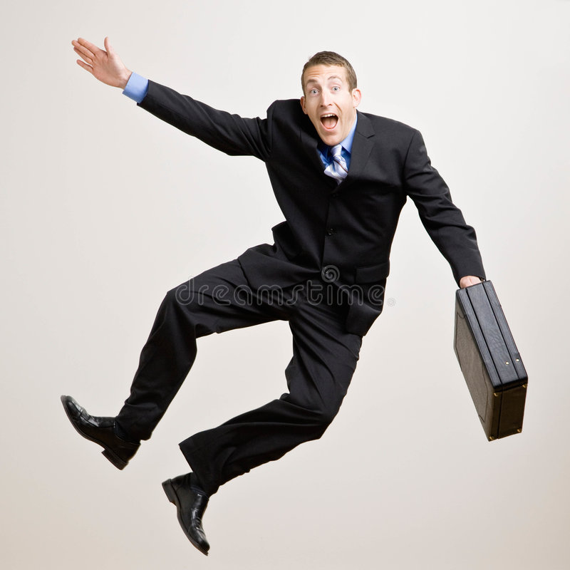 Business man jumps in the air stock photos