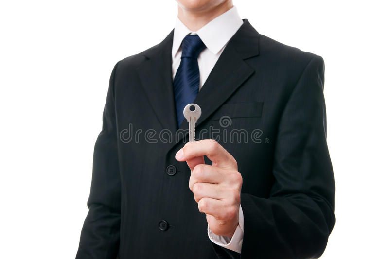 Business man with the key in the hand royalty free stock images