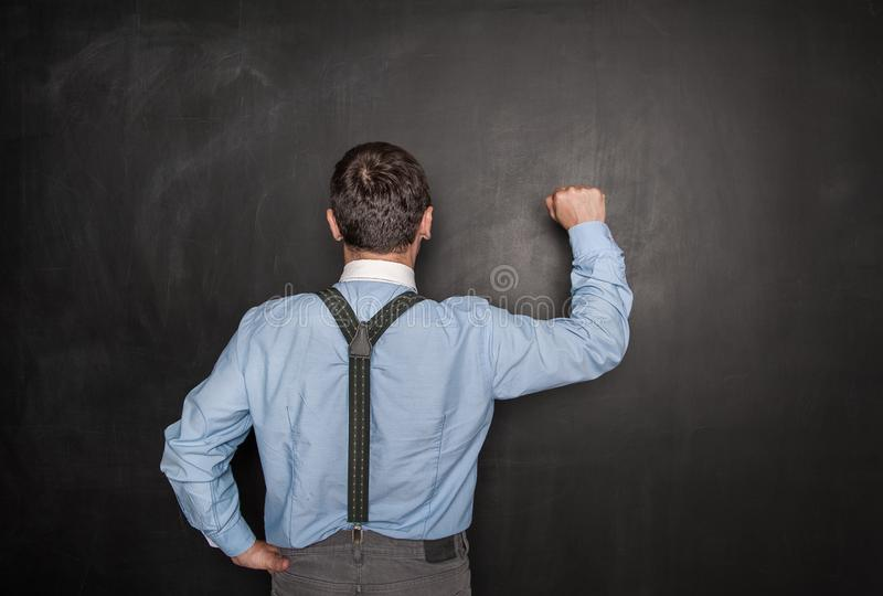Business man knock by fist on blackboard. Opportunity concept. Business man knock by fist on blackboard background. Opportunity concept royalty free stock images