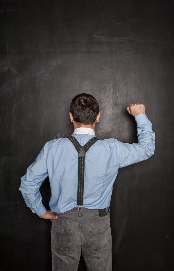 Business man knock by fist on blackboard. Opportunity concept. Business man knock by fist on blackboard background. Opportunity concept royalty free stock photos
