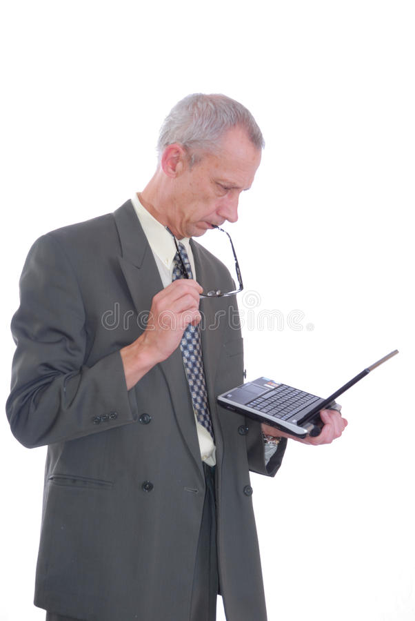 Business man with laptop and glasses. Photograph showing business type male with laptop computer isolated stock photography