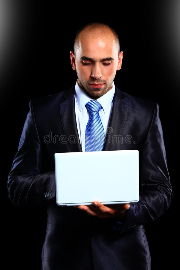 Business man with a laptop royalty free stock images