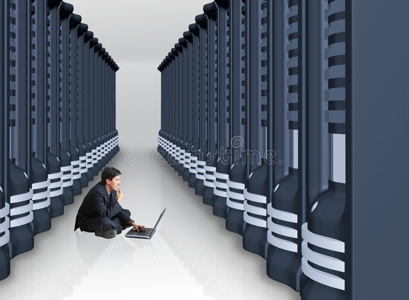 Business man with laptop in a server room