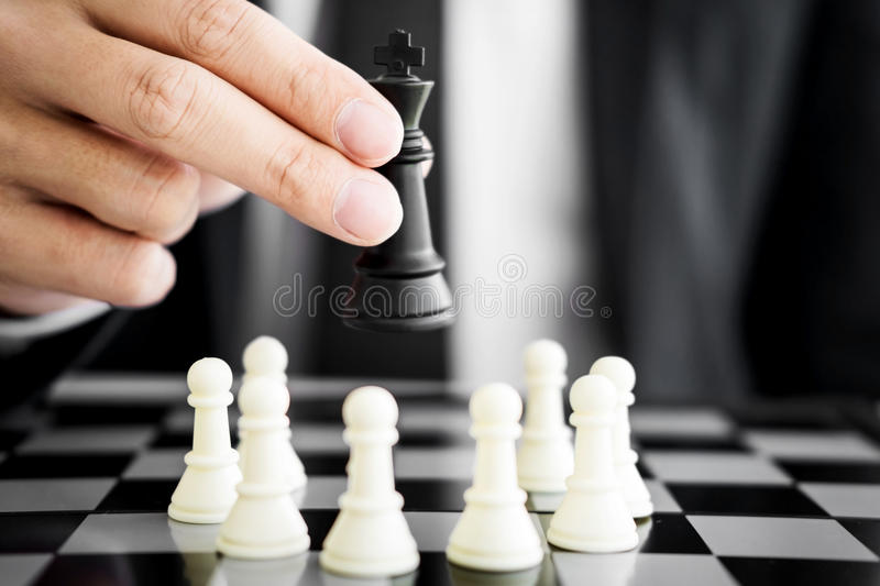 business man leader of a successful business holding the chess stock photos