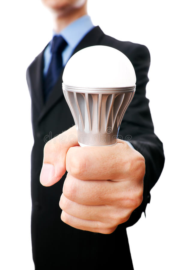 Business man with LED light bulb stock photography