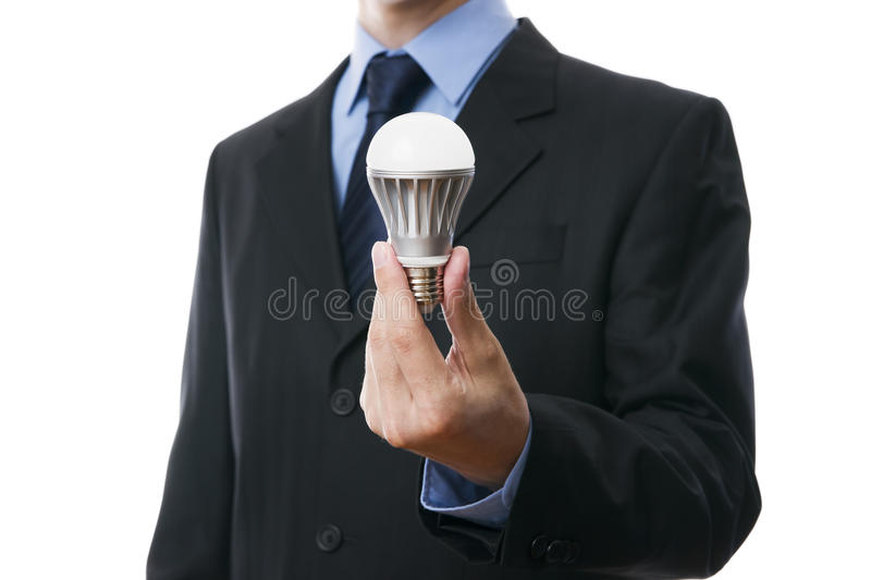 Business man with LED light bulb royalty free stock photos