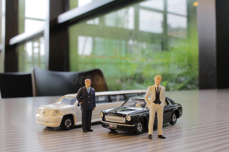 Business man with limosine car. The business man with white limosine car stock images