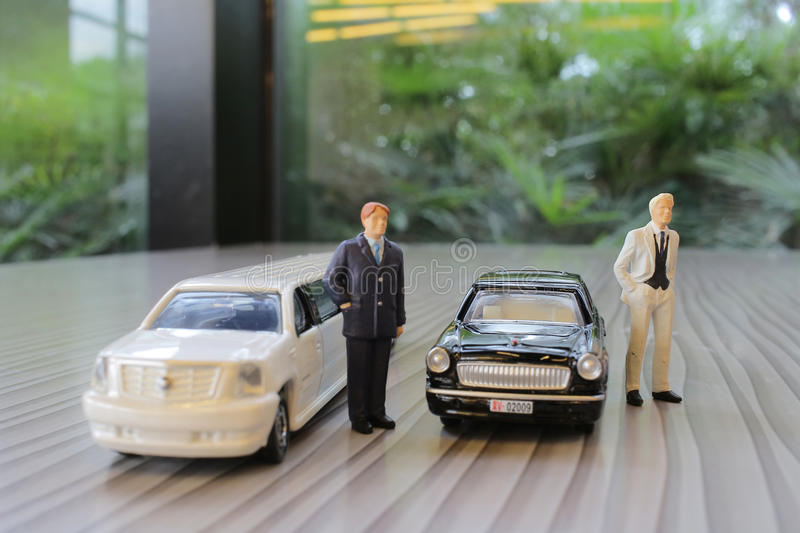 Business man with limosine car. The business man with white limosine car royalty free stock photography