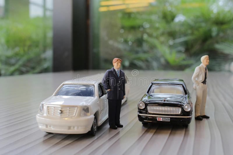 Business man with limosine car. The business man with white limosine car stock photography