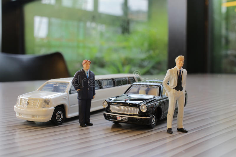 Business man with limosine car. The business man with white limosine car royalty free stock photos