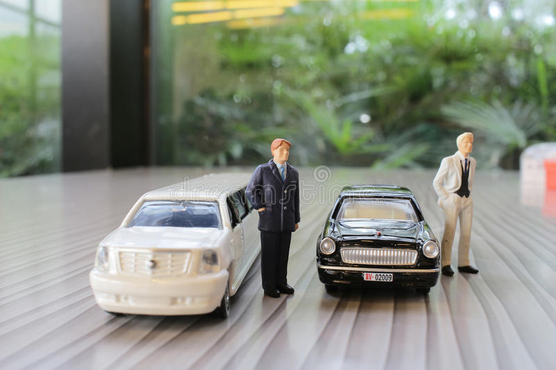 Business man with limosine car. The business man with white limosine car royalty free stock images