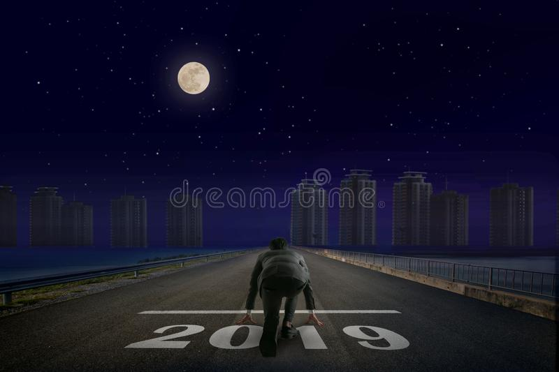 Business man 2019 line in front of city. Night back view. Elements of this image furnished by NASA. royalty free stock photography