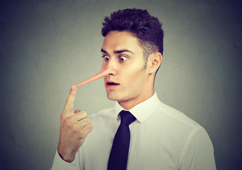 Business man with long nose. Liar concept. royalty free stock photo