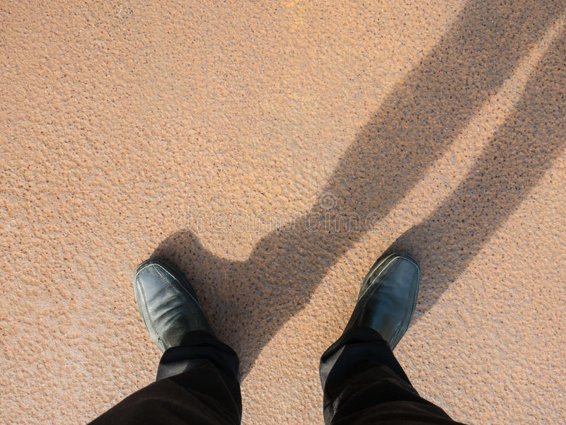 Business man look down to floor, full of rust. royalty free stock photography