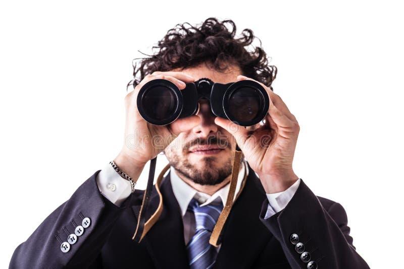 Business man looking through binoculars stock images