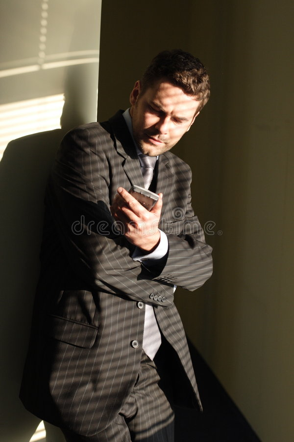 Business man looking at display of palmtop