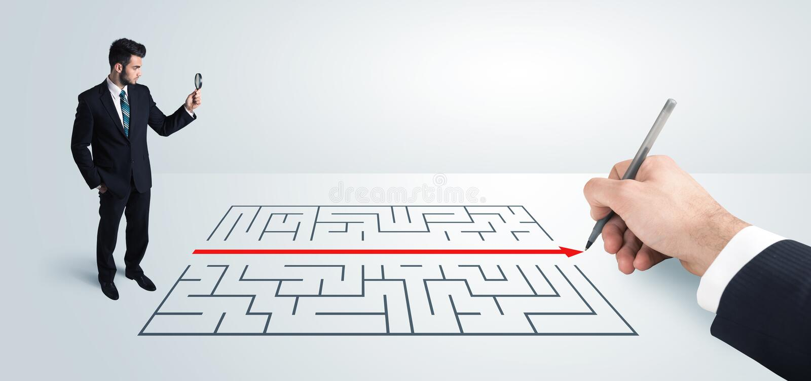 Business man looking at hand drawing solution for maze. Solution concept royalty free stock photo