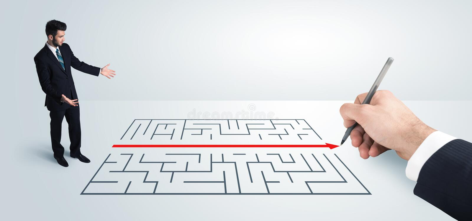 Business man looking at hand drawing solution for maze. Solution concept royalty free stock photos
