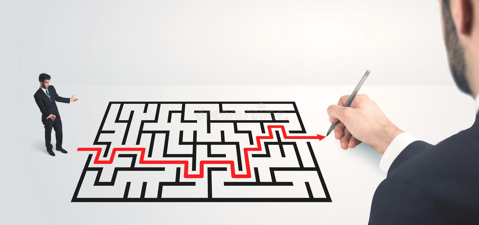 Business man looking at hand drawing solution. Maze solution concept stock photos