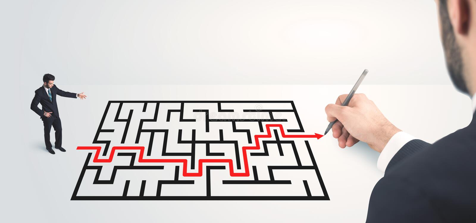 Business man looking at hand drawing solution. Maze solution concept royalty free stock image
