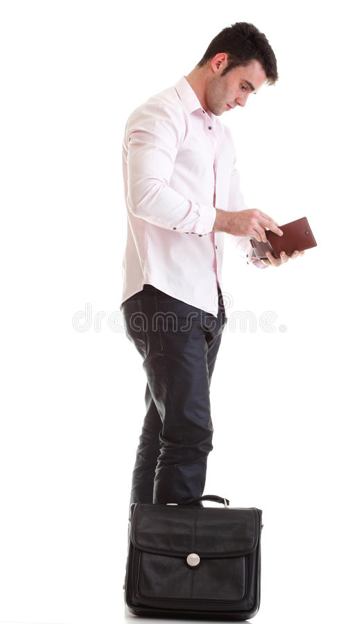 Business man looking at his empty wallet Isolated. Business man looking at his empty wallet. Isolated on a white background stock photos
