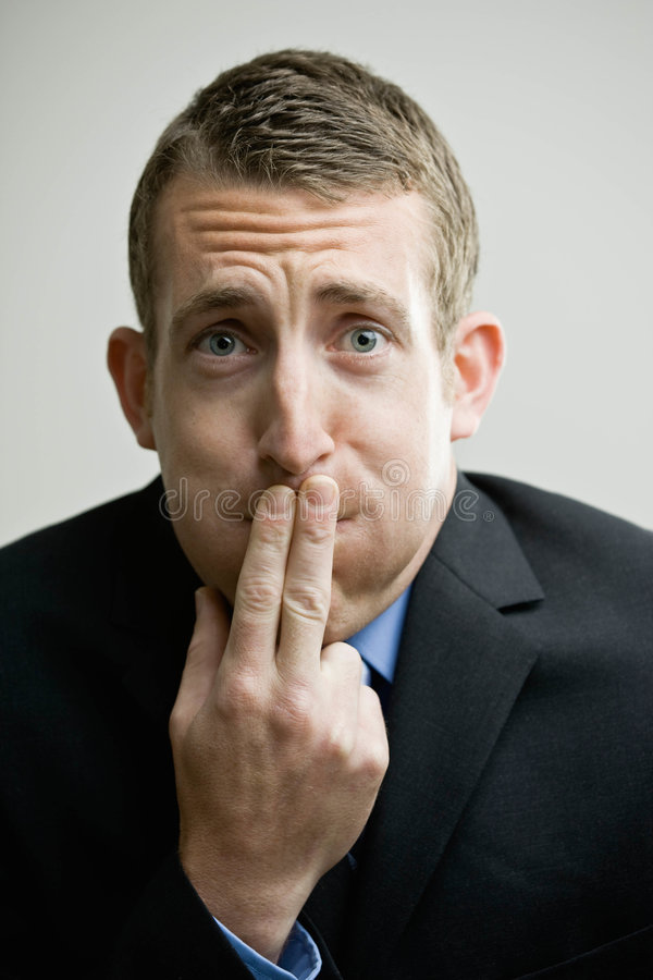 Business man looking ill. Worried businessman holding mouth afraid he might vomit royalty free stock photos