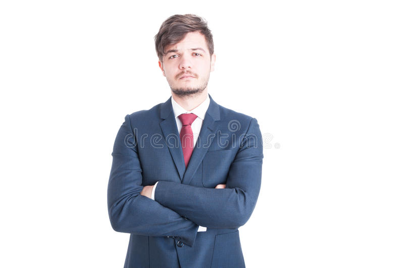 Business man looking sad posing with arms crossed. Business man wearing suit looking sad posing with arms crossed looking at camera isolated on white background royalty free stock images