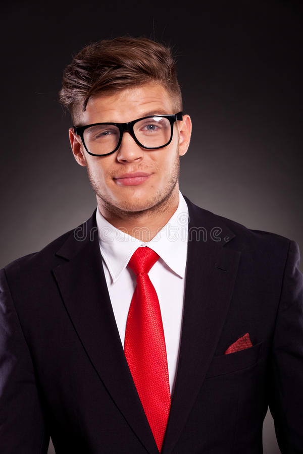Business man looking suspiciously stock image