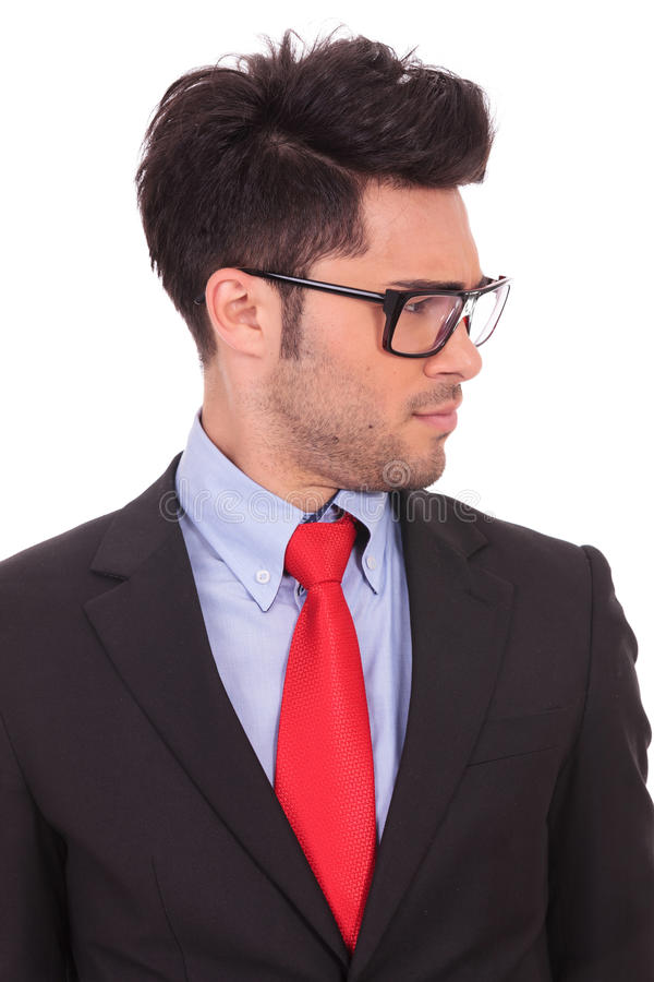 Business man looks doubtfully to side stock photo