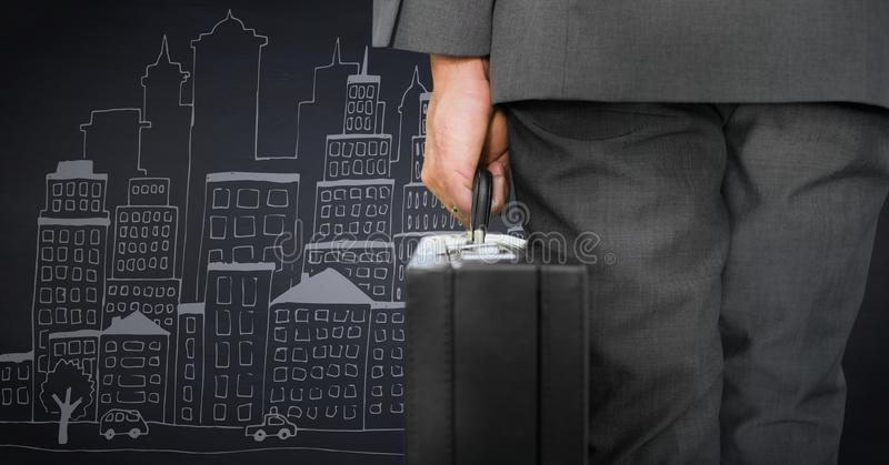 Business man lower body with briefcase against navy background with city doodle royalty free stock photos