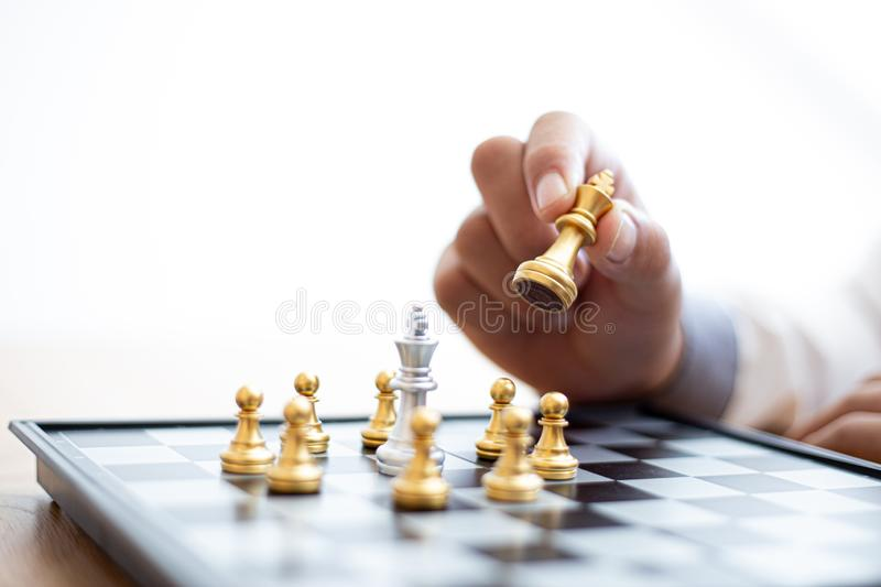 Business men make plans to play chess with Prudence and success royalty free stock image
