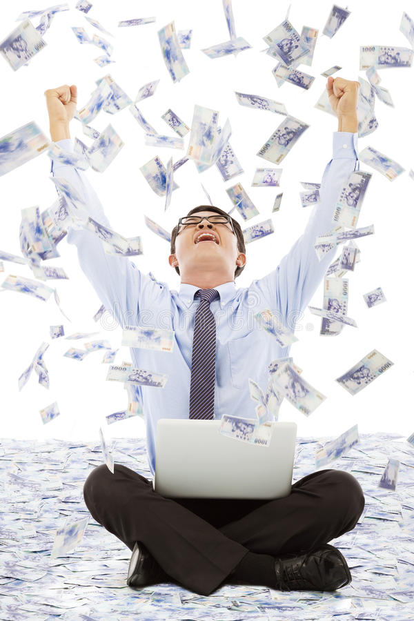 Business man making a successful pose with money rain background royalty free stock photos