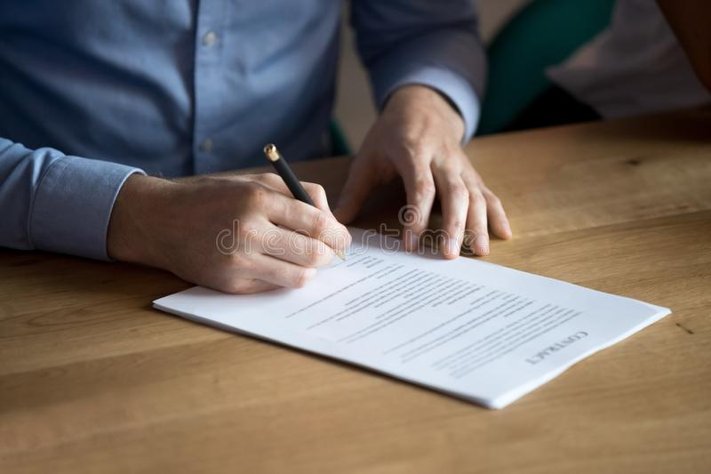 Business man customer hand sign contract, close up view. Business man manager customer hand sign contract, male client put written signature on legal paper royalty free stock photography