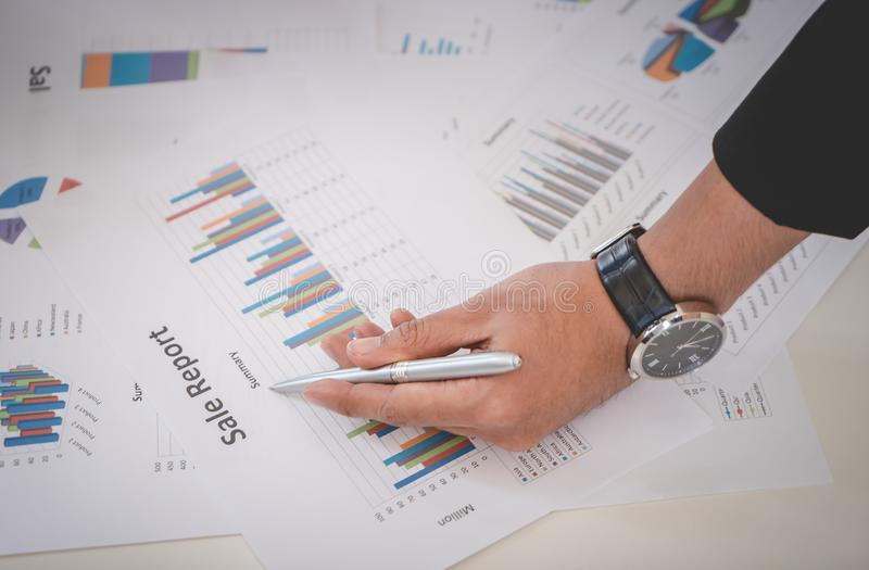 Business man marking on sheet using metal pen royalty free stock photos