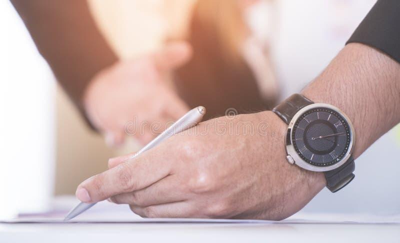 Business man marking on data sheet using pen royalty free stock image