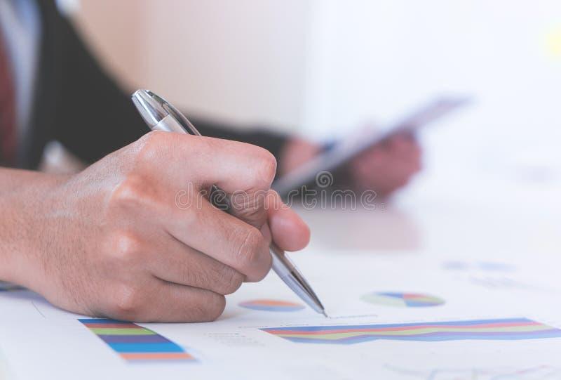 Business man marking on data sheet using pen royalty free stock photography