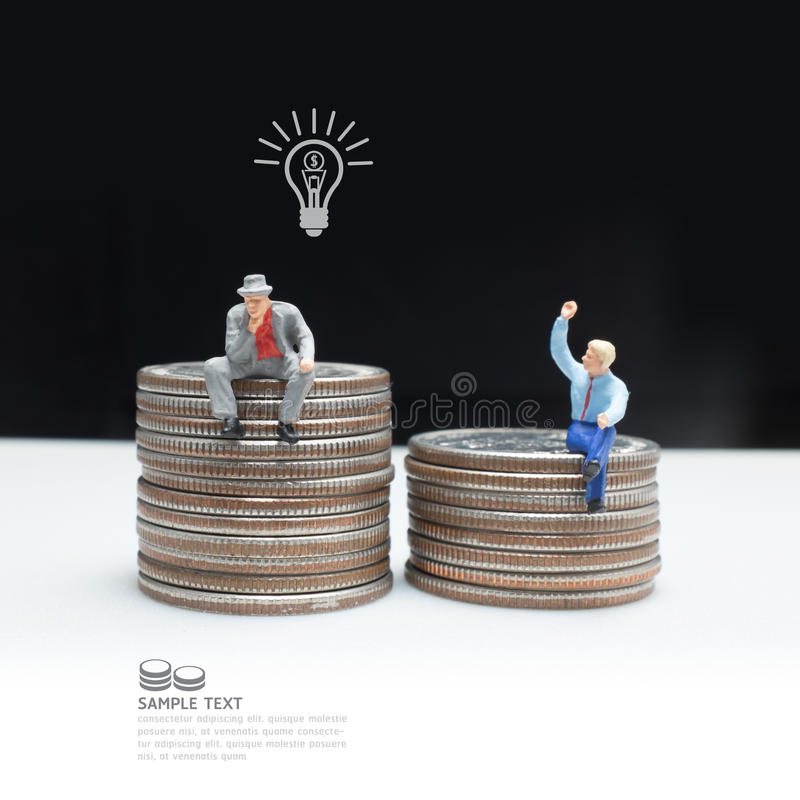 Business man miniature figure concept idea to success business. Business man miniature figure concept idea to success business with coin royalty free stock photography