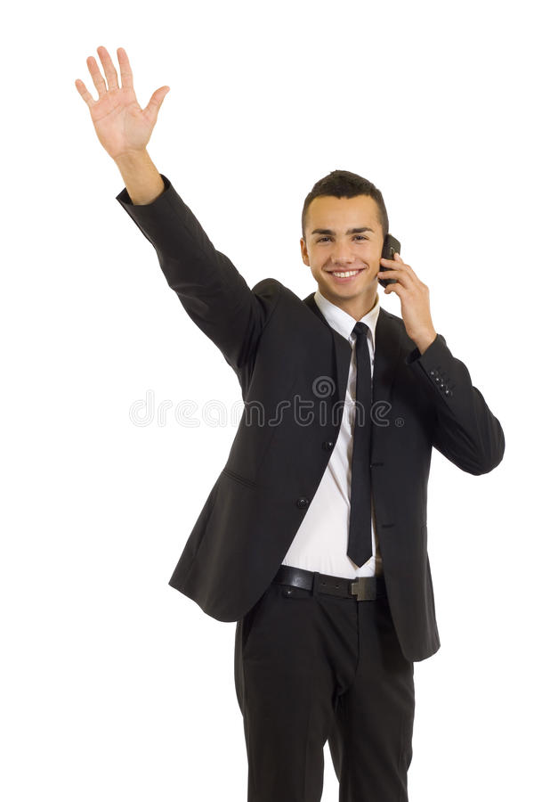 Business man on mobile phone. Happy business man talking on the mobile phone and waveing, isolated royalty free stock photos